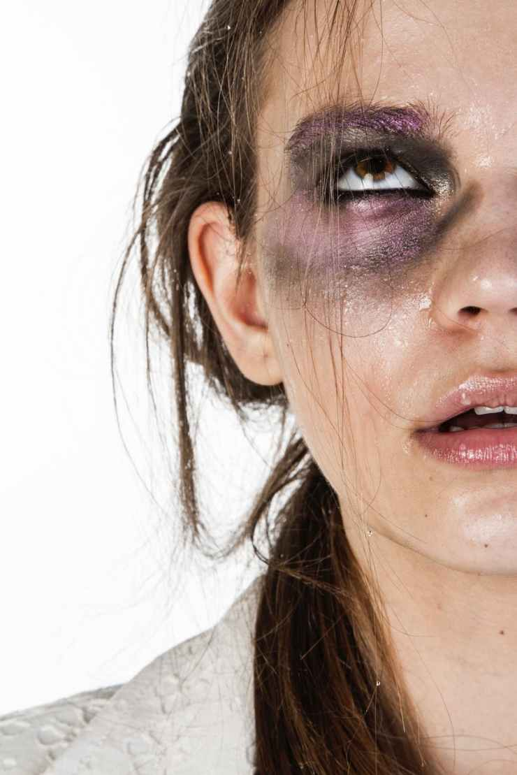 close up photo of woman with black and purple eye shadow